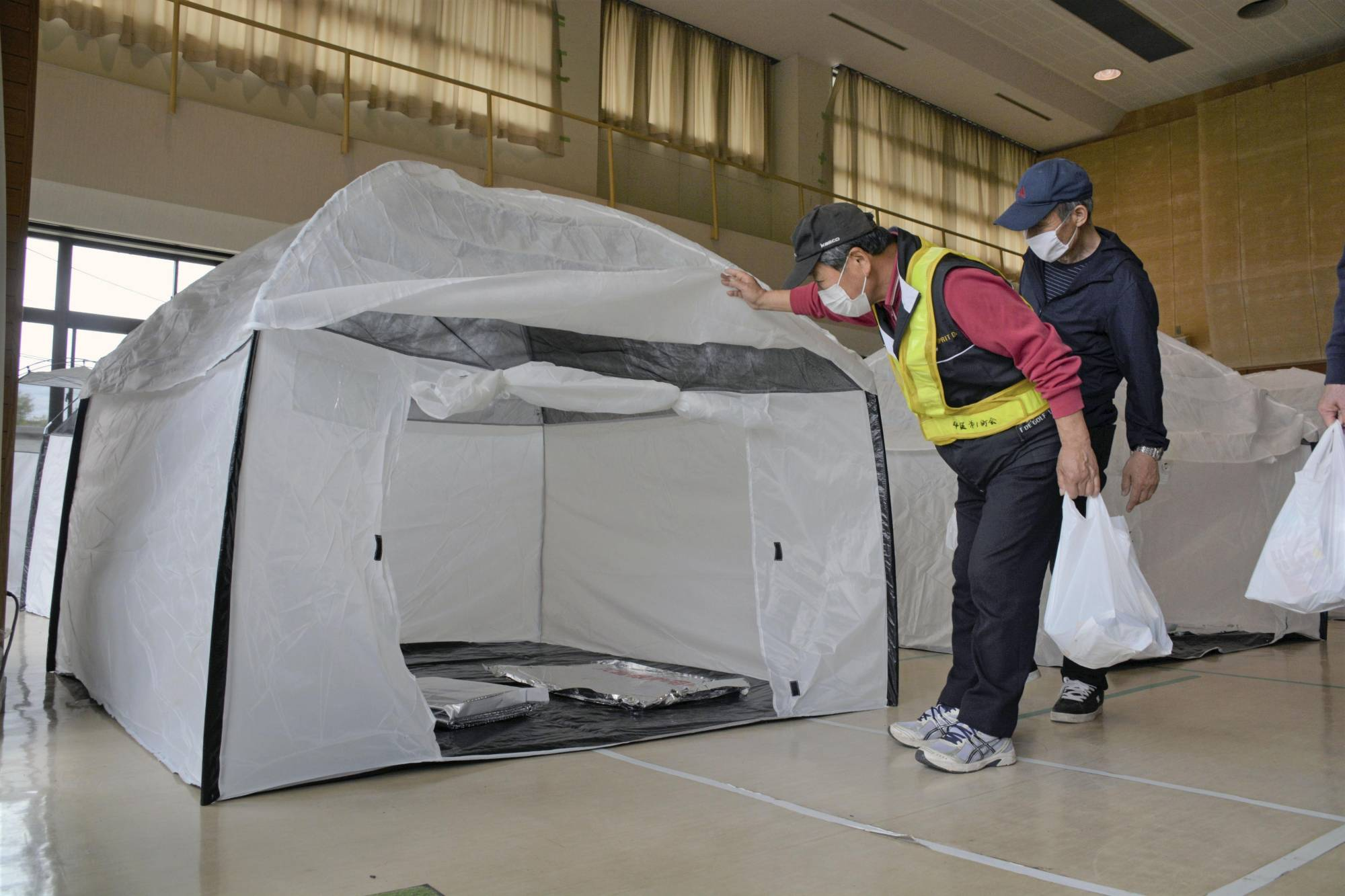 Tents are set up at an evacuation center used for a disaster drill held on May 16 in the city of Fukushima with considerations over prevention of COVID-19 infections spreading. | KYODO