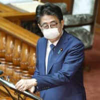 Prime Minister Shinzo Abe attends an Upper House plenary session Friday. | KYODO