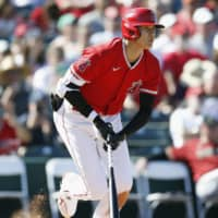 The Angels' Shohei Ohtani hits a single during a March spring-training game in Tempe, Arizona. | KYODO