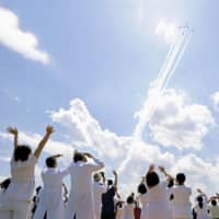 The Air Self-Defense Force's Blue Impulse aerobatics team passes over the Self-Defense Forces' Central Hospital in Tokyo's Setagaya Ward during a flyover of the capital Friday to show appreciation to medical workers fighting the coronavirus outbreak. | KYODO