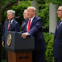 U.S. President Donald Trump holds a news conference on China in the Rose Garden of the White House in Washington on Friday. | AFP-JIJI