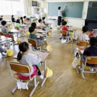 School pupils observe social distancing in their class to reduce the risk of infections with the coronavirus disease during a recent class at an elementary school in Ise, Mie Prefecture.  | KYODO