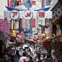 Customers return to the popular Ameyoko shopping district in Tokyo's Taito Ward. A recent survey shows most of the 47 prefectures have already lifted or will soon lift requests for businesses to close as the coronavirus epidemic wanes. | AFP-JIJI