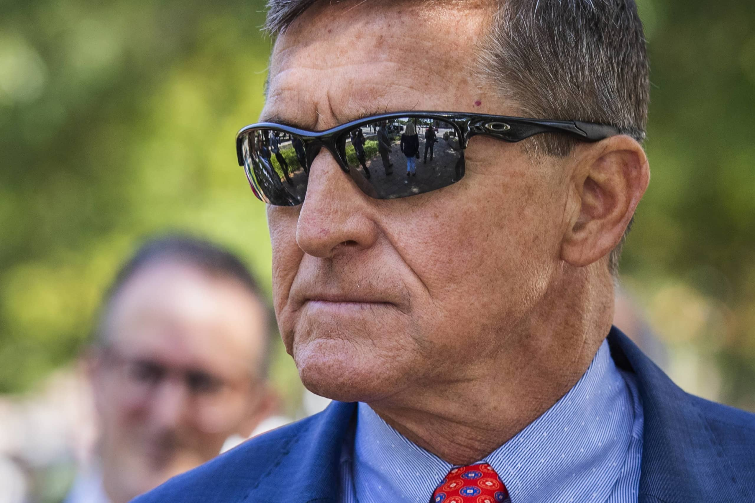 Former U.S. national security adviser Michael Flynn leaves federal court following a status conference in Washington last September. | AP