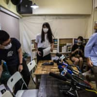 Joshua Wong (left), Nathan Law (center) and Agnes Chow, of pro-democracy political group Demosisto, give a news conference in Hong Kong on Saturday. | AFP-JIJI