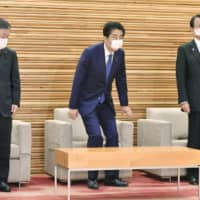Prime Minister Shinzo Abe attends a Cabinet meeting Friday in Tokyo. | KYODO