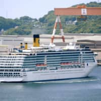 Virus-hit Italian cruise ship leaves Nagasaki