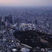 The Tokyo Olympics are scheduled to begin at National Stadium on July 23, 2021, but medical experts have warned that holding the event then would be very unrealistic without a vaccine. | KYODO
