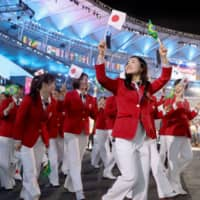 Table tennis player Mima Ito joins other Japanese athletes at the opening ceremony of the 2016 Rio Olympics. | KYODO