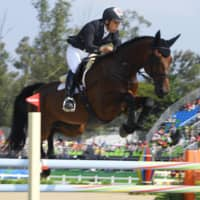 Yoshiaki Oiwa competes in the showjumping discipline of three-day eventing at the 2016 Rio Olympics. | KYODO