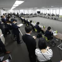 An expert panel discusses measures to tackle the COVID-19 outbreak at the health ministry Friday.   KYODO