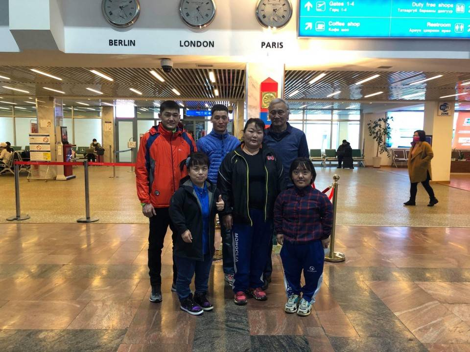 Members of Mongolia's para athletics team pose for a photograph at Chinggis Khaan International Airport in Ulaanbaatar in February. | COURTESY OF YAIZU CITY / VIA KYODO