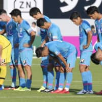 Sagan players bow to fans after a loss to Yokohama F. Marinos on Nov. 2 in Tosu, Saga Prefecture. | KYODO
