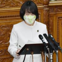 Center stage: Japanese Communist Party lawmaker Tomoko Tamura questions the ruling coalition about its response to COVID-19 in the Upper House on April 27. | KYODO
