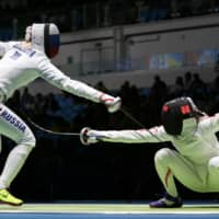 Nozomi Sato (right) competes against Russia's Tatiana Logunova during the preliminary round at the Rio Olympics on August 6, 2016 in Rio de Janeiro. | REUTERS