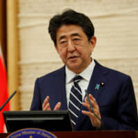 Prime Minister Shinzo Abe speaks at a news conference on Japan's response to the coronavirus pandemic, in Tokyo on May 25. | POOL / VIA REUTERS