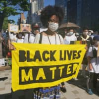 In support: People from all walks of life join a Black Lives Matter march in Osaka on Sunday.  | AYANA WYSE