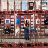 An attendee browses inside a new Uniqlo store in Harajuku on June 3. | BLOOMBERG