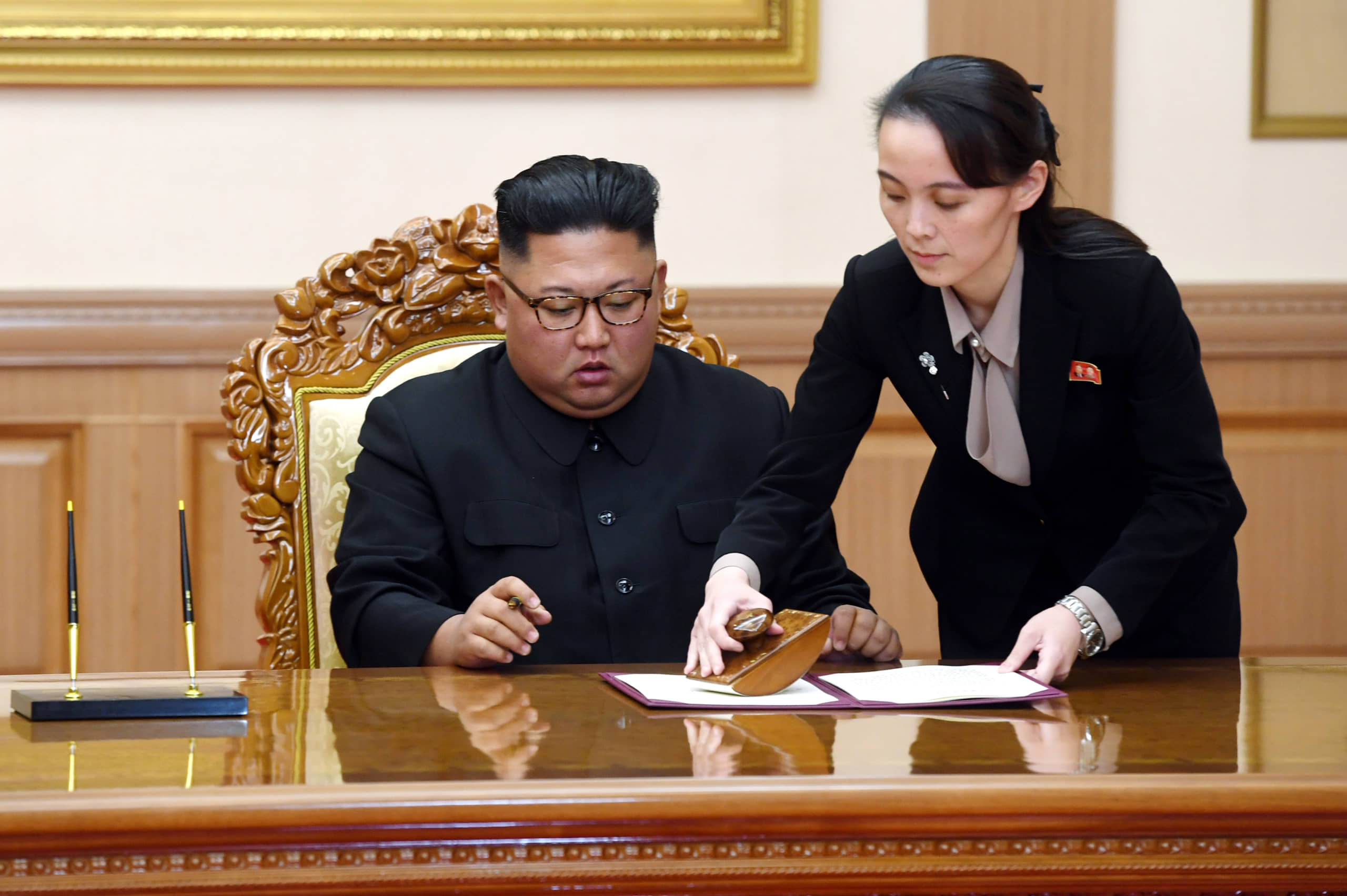 Kim Yo Jong helps her brother, North Korean leader Kim Jong Un, sign a joint statement following a summit with South Korean President Moon Jae-in at the Paekhwawon State Guesthouse in Pyongyang in September 2018.   PYONGYANG PRESS CORPS POOL / VIA AP