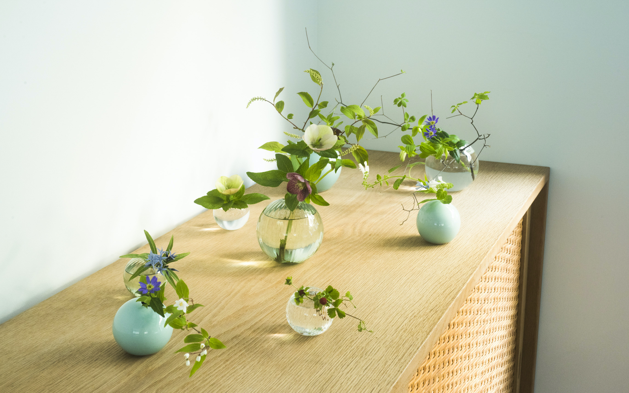The One Flowerware bud vases are all the same shape, but made in various materials by different artisans. | YUDAI KUSANO