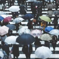 Umbrellas up: Anyone who has experienced rainy season in Japan will tell you that a portable umbrella is the best way to deal with sudden downpours. | GETTY IMAGES