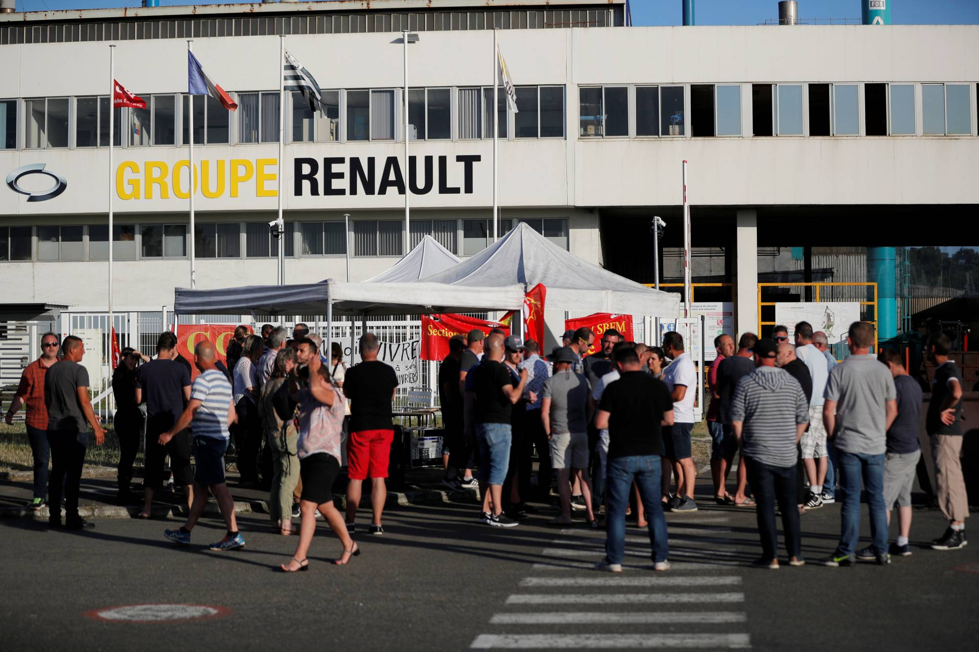 Renault workers gather in front of the Fonderie de Bretagne, a subsidiary of Groupe Renault, in Caudan, France, on Thursday.   REUTERS