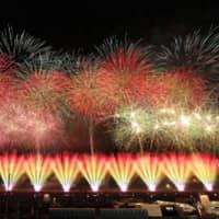 A national fireworks contest is held in Daisen, Akita Prefecture, last August. | KYODO