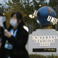 People visit Universal Studios Japan in Osaka on Feb. 28, a day before it was closed to help curb the spread of COVID-19 infections. | KYODO