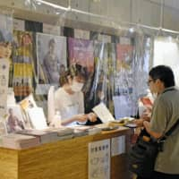 Reopening libraries and cinemas, Tokyo adapts to new normal