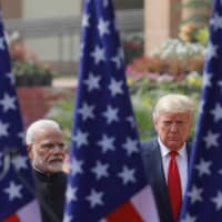 U.S. President Donald Trump and Indian Prime Minister Narendra Modi meet in February. Growing tensions between India and China present Washington with an opportunity to further strengthen ties with New Delhi, which is becoming a key ally in the U.S. effort to contain Beijing's Indo-Pacific ambitions.  | REUTERS