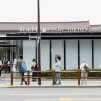 Visitors line up in front of the Tokyo National Museum on Tuesday as they wait for its reopening following a three-month closure due to the coronavirus pandemic. | KYODO