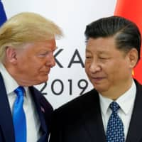 U.S. President Donald Trump meets with Chinese leader Xi Jinping at the start of their bilateral meeting at the Group of 20 leaders summit in Osaka last June. | REUTERS