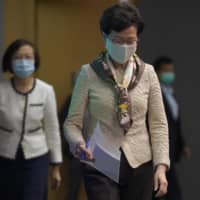 Hong Kong Chief Executive Carrie Lam has criticized the 'double standards' of foreign governments over national security and pointed to recent unrest in America as an example.  | AP