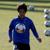 Mu Kanazaki, then with Kashima, warms up during a practice session ahead of the FIFA Club World Cup Final on Dec. 17, 2016, in Yokohama.    practice sesssion  training ahead of the FIFA Club World Cup Final match against Real Madrid. REUTERS/Toru Hanai | REUTERS