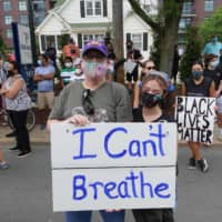 Jeff Austin and his daughter Lily Henry-Austin protest police brutality against African Americans in Bethesda, Maryland, on Tuesday.  | AFP-JIJI