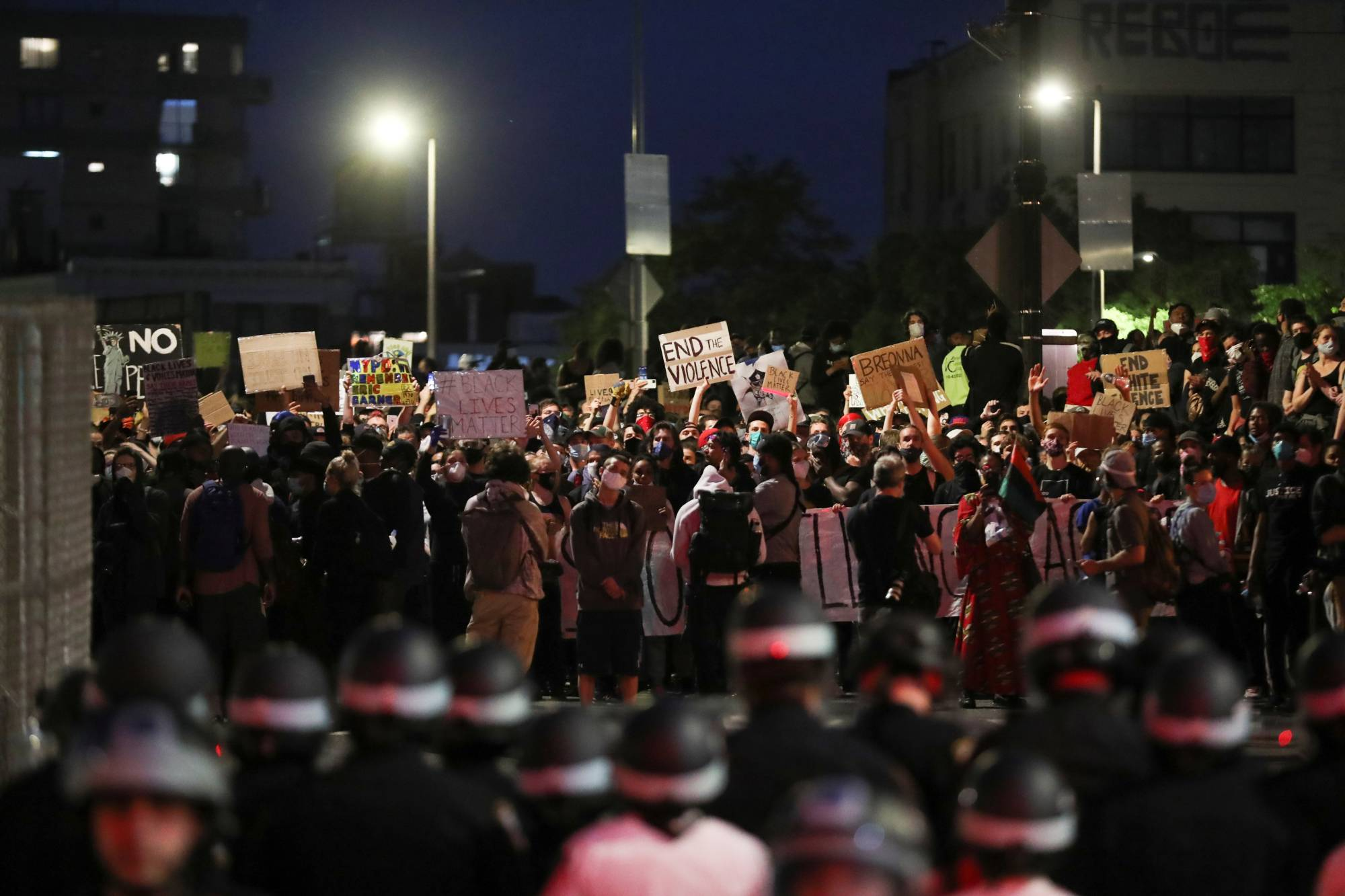 People gather during a protest against George Floyd's death while in Minneapolis police custody, in the Manhattan borough of New York City on Tuesday. | REUTERS