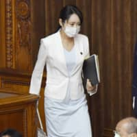 Justice Minister Masako Mori leaves the Upper House plenary session on May 13 after responding to questions. | KYODO