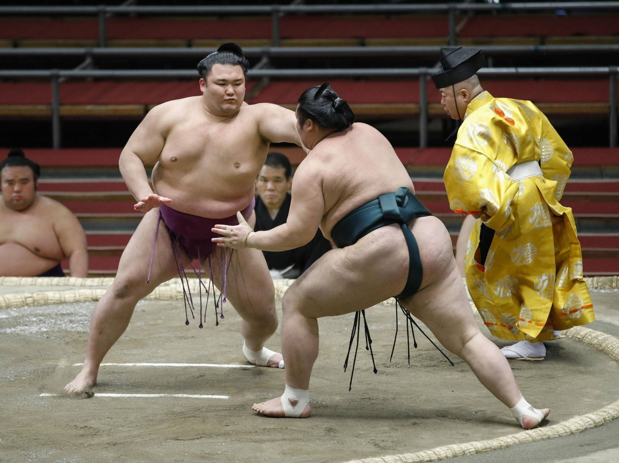 Asanoyama (left) is the third consecutive rikishi with a background in amateur sumo to reach the rank of ozeki. | KYODO