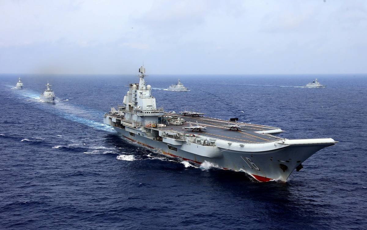 Chinese People's Liberation Army Navy aircraft carrier Liaoning takes part in a military drill in the western Pacific Ocean on April 18, 2018. China says it will increase its defense spending by 6.6 percent in 2020, despite a major downturn in the country's economic growth due to the coronavirus outbreak. | REUTERS