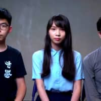 Hong Kong pro-democracy activists Joshua Wong (left), Agnes Chow (center) and Au Nok-hin give an online news conference set up by the Foreign Correspondents' Club of Japan on Wednesday. | JESSE JOHNSON