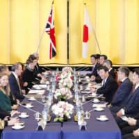 Foreign Minister Toshimitsu Motegi (fifth from right) and his British counterpart Dominic Raab (fifth from left) hold talks in Tokyo on Feb. 8. | KYODO