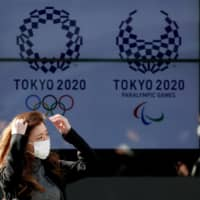A screen in Tokyo displays the logos for the 2020 Summer Olympics and Paralympics. | REUTERS