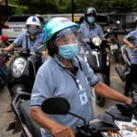 Surin Makradee, 77, is part of a network of more than 1 million community workers in Thailand who have been called 'unsung heroes' in the fight against the coronavirus.  | REUTERS
