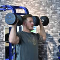 New Obic Seagulls quarterback Jimmy Laughrea works out Wednesday at Vita Base, a sports gym in Narashino, Chiba Prefecture. | HIROSHI IKEZAWA