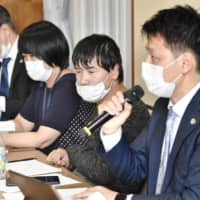 Yasuhide Uchiyama, second from right, attends a news conference on Thursday after the Nagoya District Court rejected his request to overturn an Aichi prefectural commission's decision deeming him ineligible for victims' compensation as a surviving family member after his same-sex partner was murdered. | KYODO
