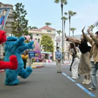 Universal Studios Japan to prohibit high fives and hugs
