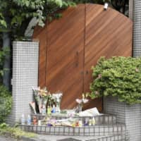 Flowers are placed at a shooting location for the Netflix reality show 'Terrace House' in Tokyo on May 25. Hana Kimura, a 22-year-old female professional wrestler who was among the show's cast, died by suspected suicide May 23 after being attacked by cyberbullies. | KYODO