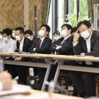 Lawmakers of the opposition camp attend a hearing on the government's tourism-boosting campaign at the Diet building on Thursday.  | KYODO