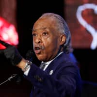 Rev. Al Sharpton speaks during a memorial service for George Floyd in Minneapolis on Thursday. | REUTERS