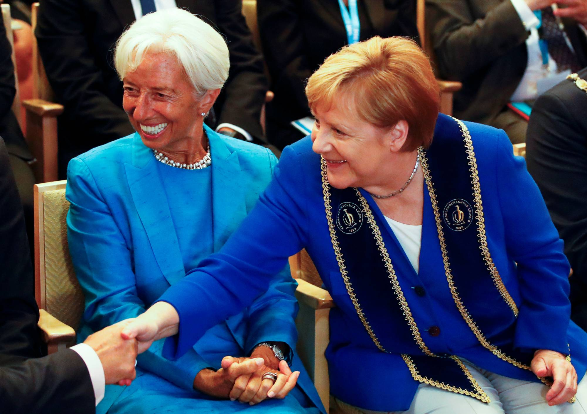 Christine Lagarde, then-head of the International Monetary Fund, and German Chancellor Angela Merkel attend a ceremony in Leipzig, Germany, in August 2019. | REUTERS